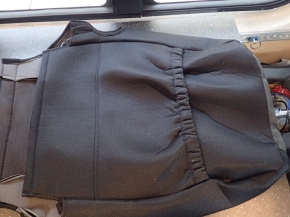 The seat back cover has a large storage pouch