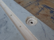 I recessed holes for the factory floor mounts with a hole saw and chisel